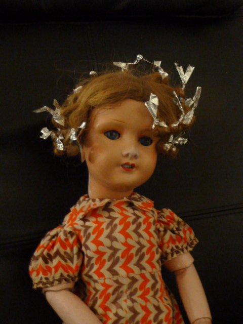 MIMI la poupée est restaurée.