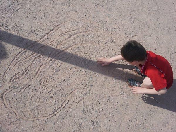 dessin sur le sable