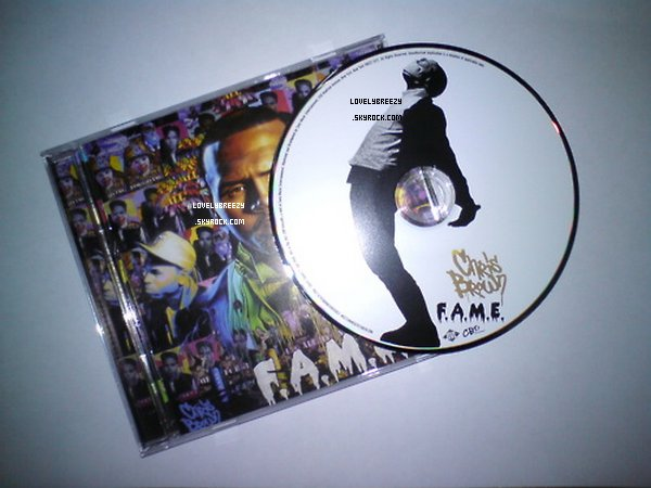 L'album F.A.M.E et le CD ( image en HD )