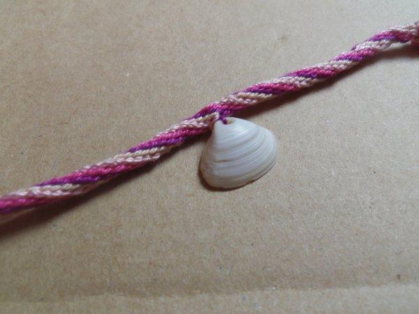 Bracelet en roue avec un coquillage