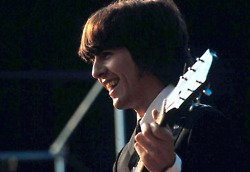 While my Guitar Gently Weeps... George