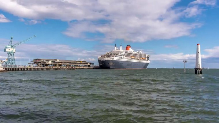Queen Mary 2 leaving Melbourne seen from a drone