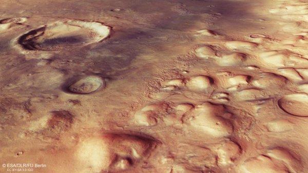 L'IMAGE DU JOUR : Cette vue en perspective dans la région Pouteau Nili sur la planète Mars a été prise à partir de la caméra stéréo à haute résolution de la sonde Mars Express de l'ESA. La scène fait partie de la région imagée par la caméra stéréo à haute résolution de Mars Express de l'ESA. L'image principale est centrée sur 36ºN / 60ºE et la résolution au sol est d'environ 15 m par pixel. (Source ESA)