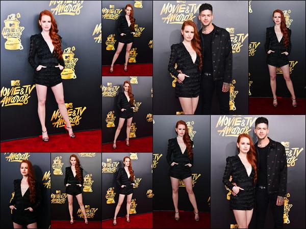 . 07.05.17 - Madelaine Petsch s'est rendue sur le red carpet des«MTV Movie And TV Awards», ayant lieu dans LA ! Toujours en compagnie de son sexy petit-ami Travis Mills la belle rousse à conquit les photographes dans sa sublime tenue noire, gros top .