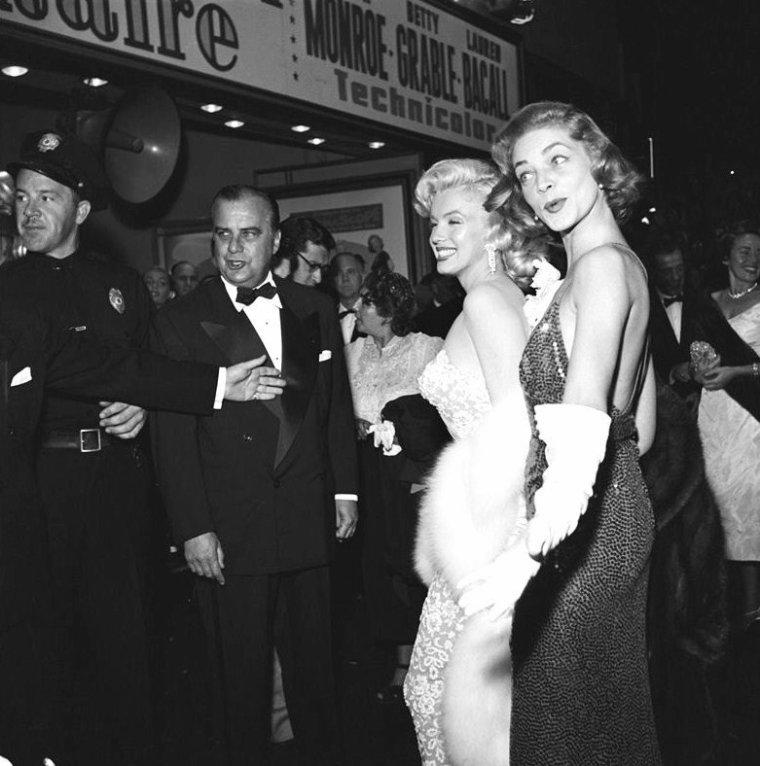 """Le 4 Novembre 1953 a lieu, au Fox Wilshire Theater, la Première du film """"Comment épouser un millionnaire"""" ; Lauren BACALL est accompagnée de son mari Humphrey BOGART, Marilyn pose avec le scénariste Nunnally JOHNSON, quand à Betty GRABLE, on ne la verra pas. De nombreuses STARS, telles Mitzi GAYNOR, Rock HUDSON, Shelley WINTERS, Robert MITCHUM ou encore Debbie REYNOLDS, seront de la fête..."""