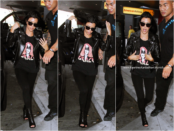 13/09/2015 : Kourtney et son fils Reign arrivant à l'aéroport LAX de Los Angeles.