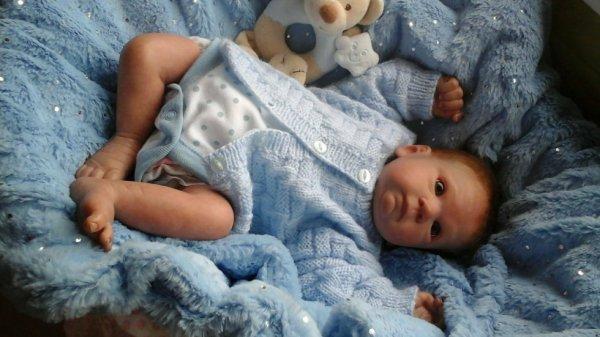 Gilet bleu pour le bébé de Monique