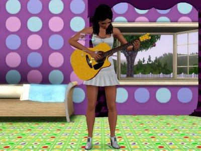 Fergie qui joue de la guitare