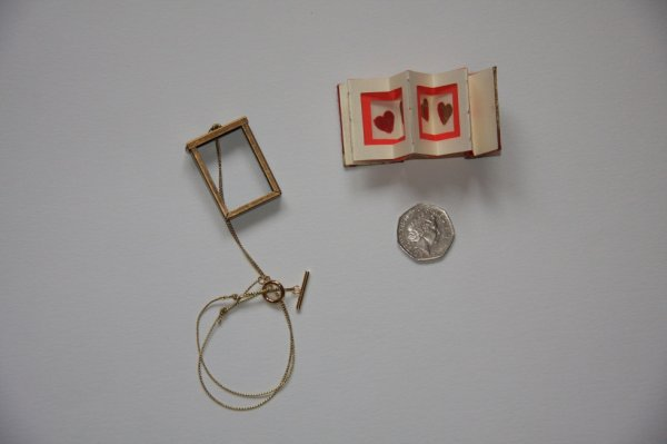 Miniature book as necklace