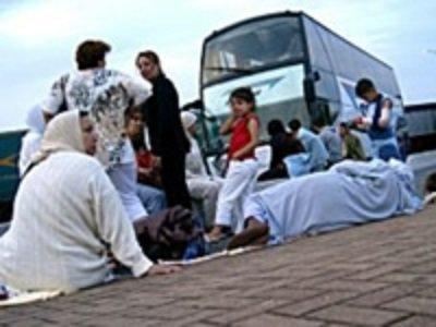 03-07-2007 - Belgique - Saisie et immobilisation sur place de 3 autocars Belge (Bruxelles Midi ) partis pour le Maroc, non respect des législations en vigueur