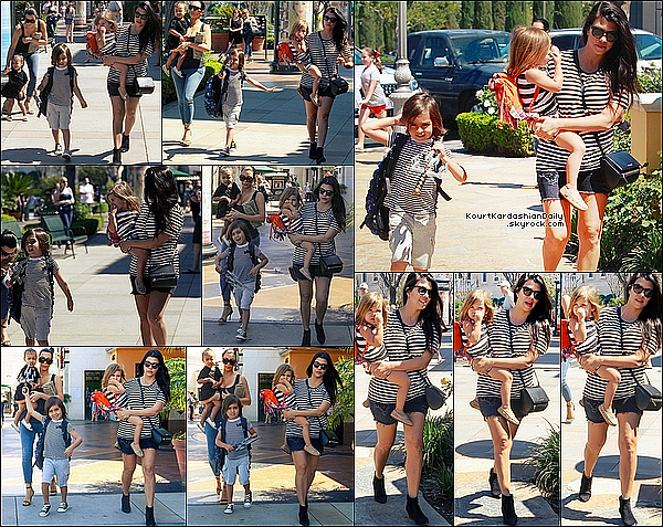 . 28/o3/2o15 : Kourtney & Kim ont emmenées Mason, Penelope & North « au Cinéma » - à Calabasas. ● Kourtney porte un sac Givenchy à 1836¤ & des Bottines Yves Saint-Laurent.   .