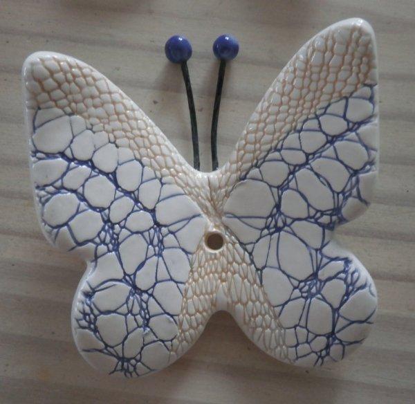Papillons en faïence