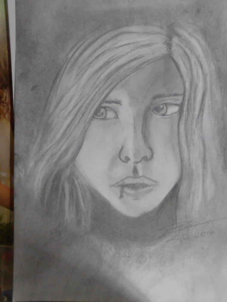 un autre essais de portraits  au fusain