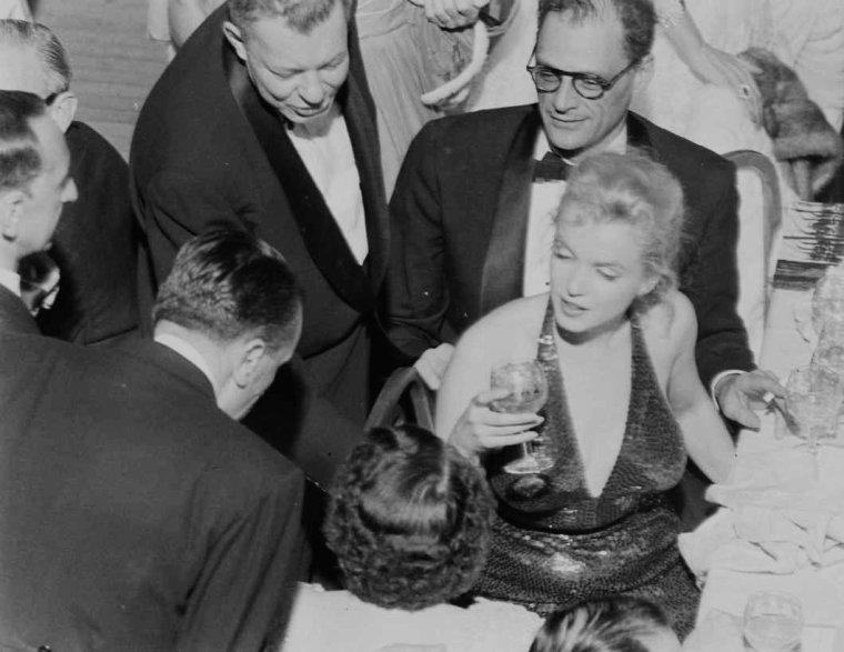 """1957 Bal """"April in PARIS"""" / Le couple MILLER assista à une soirée de gala fêtant le 200ème anniversaire de la naissance de LAFAYETTE, au Waldorf Astoria de  New York.  Elsa MAXWELL, Gérard PHILIPE et Jean MARAIS, entre autres, assistèrent à cette soirée."""