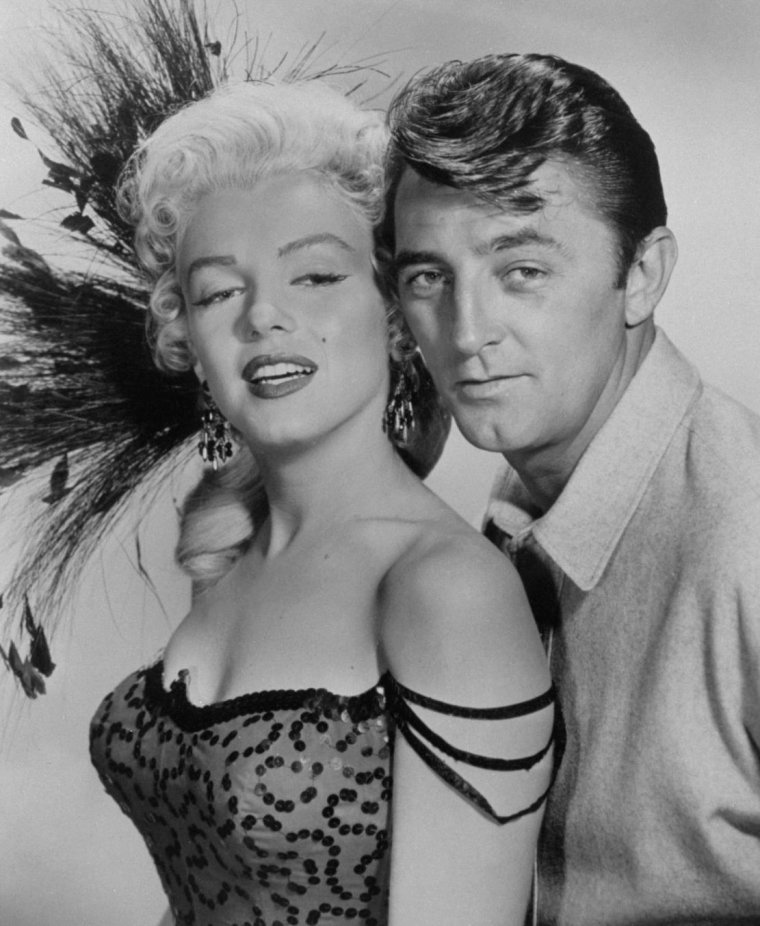 "1954 / Photos publicitaires de Marilyn aux côtés de Robert MITCHUM ou Rory CALHOUN pour le film ""River of no return""."