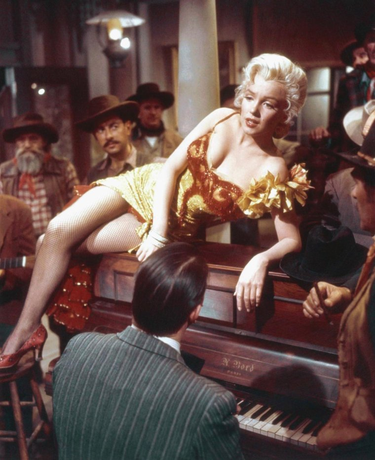 "1954 / by J.R. EYERMAN... Scène finale du film ""River of no return"" où Marilyn chante la chanson du même nom."