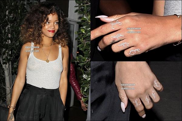 * 26/01/2012':' Rihanna a été vue quittant son restaurant préféré, le « Giorgio Baldi » à Los Angeles.   + On peut voir sur les photos son nouveau tatouage « Thug Life » sur ses mains, en hommage au rappeur Tupac (2Pac). T'aimes? *