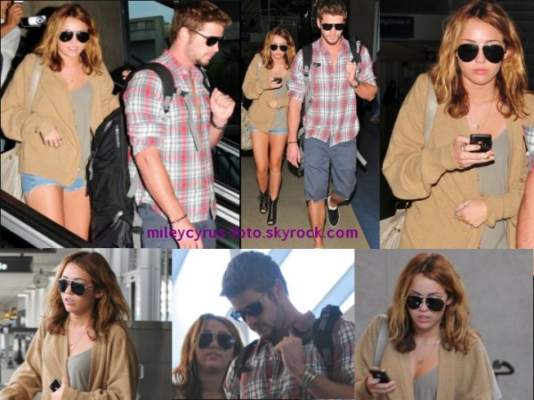 Miley Cyrus avec son boyfriend Liam Hemsworth à l'aéroport LAX hier.
