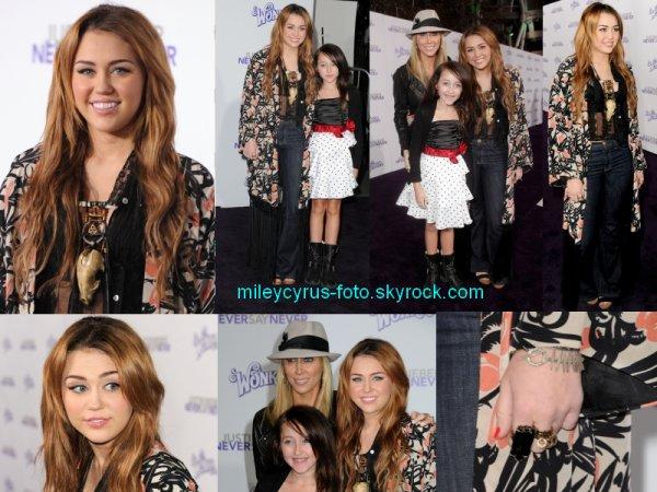 Comme prévu, Miley était présente à l'avant première du film de Justin Bieber « Never Say Never » hier au Nokia Theater de Los Angeles. Je vous propose de retrouver les photos du tapis rouge.
