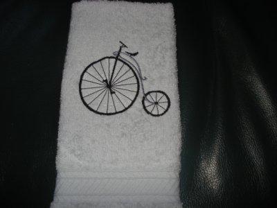 Essuie d'invité avec vélo