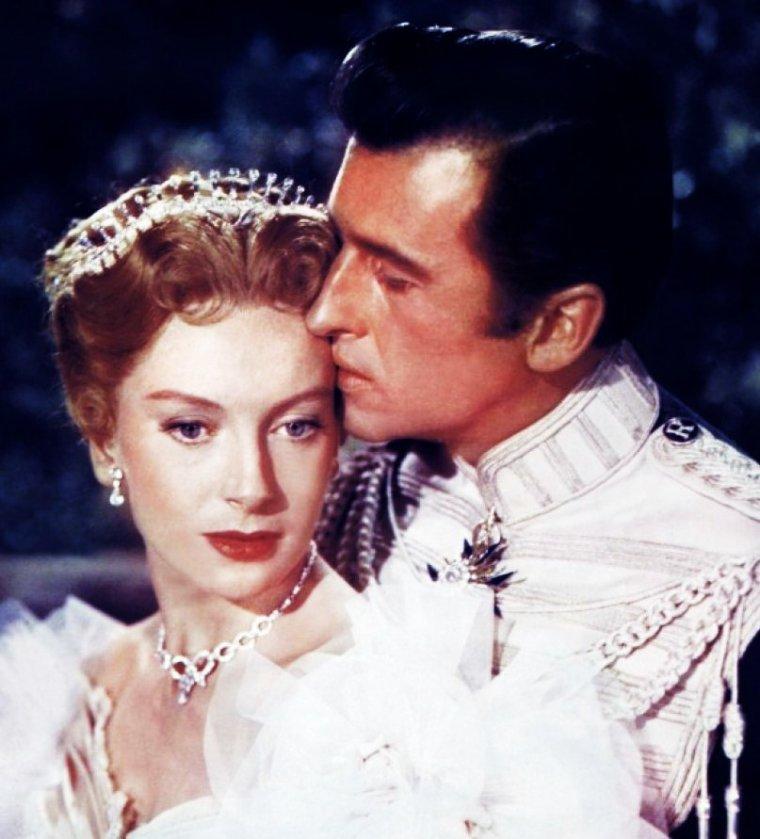 """COUPLES au cinéma... / de haut en bas / Ann TODD and Gregory PECK dans """"Le procès Paradine"""" (1947) / Angie DICKINSON and Dean MARTIN dans """"L'inconnu de Las Vegas"""" (1960) / Deborah KERR and Stewart GRANGER dans """"Le prisonnier de Zenda"""" (1952) / Doris DAY and Rock HUDSON dans """"Ne m'envoyez pas de fleurs"""" (1964) / Grace KELLY and Clark GABLE dans """"Mogambo"""" (1953) / Eve BRENT and Gordon SCOTT dans """"Tarzan's fight for life"""" (1958) / Ingrid BERGMAN and Cary GRANT dans """"Les enchaînés"""" (1946) / Judy GARLAND and Mickey ROONEY dans """"Strike up the band"""" (1940)."""