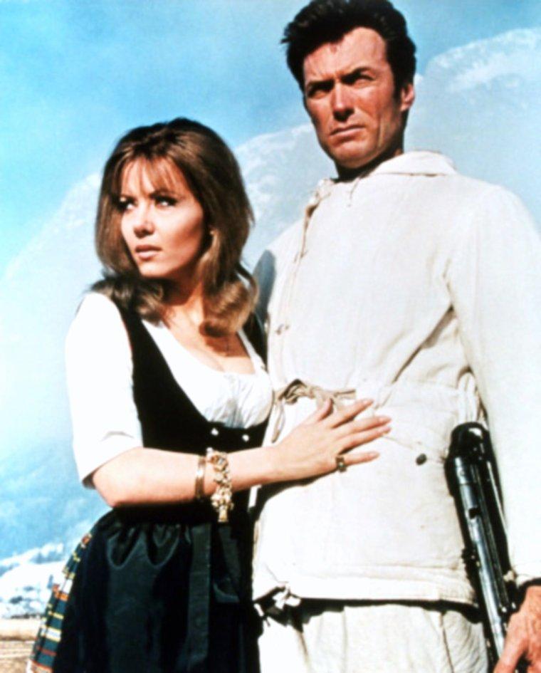 """1968 / Ingrid PITT et Mary URE se partagent la vedette aux côtés de Richard BURTON ou Clint EASTWOOD, dans le film """"Quand les aigles attaquent"""" (Where eagles dare) de Brian G HUTTON / SYNOPSIS / En 1944, un commando britannique est parachuté en Autriche près du village de Werfen dans le länd de Salzbourg (dans les Alpes autrichienne à moins de 40 km au sud-est de Berchtesgaden et du nid d'aigle d'HITLER en Bavière) pour récupérer un général américain, prisonnier dans une forteresse nazie, le Hohenwerfen (« Château des aigles »). Mais très vite, deux membres du commandos meurent et il semble qu'au moins trois autres jouent un double jeu."""