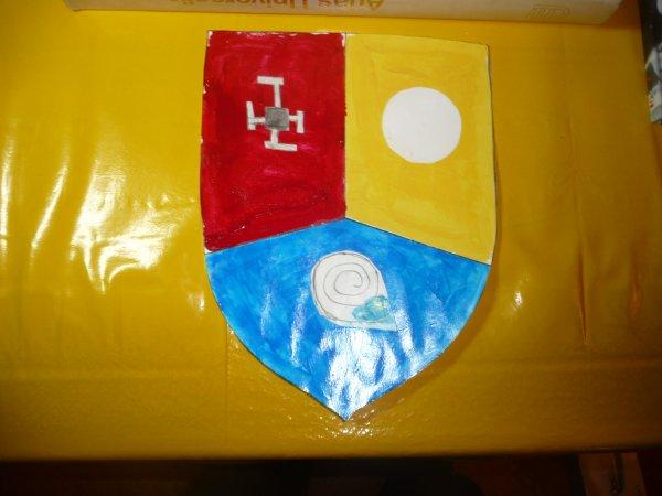 Le blason a multi symbolique kalirienne avec de la peinture de Gortysk ou Kaliroust le penseur mystérieux.