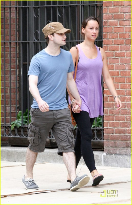 Dan walking hand in hand with his girlfriend in NYC