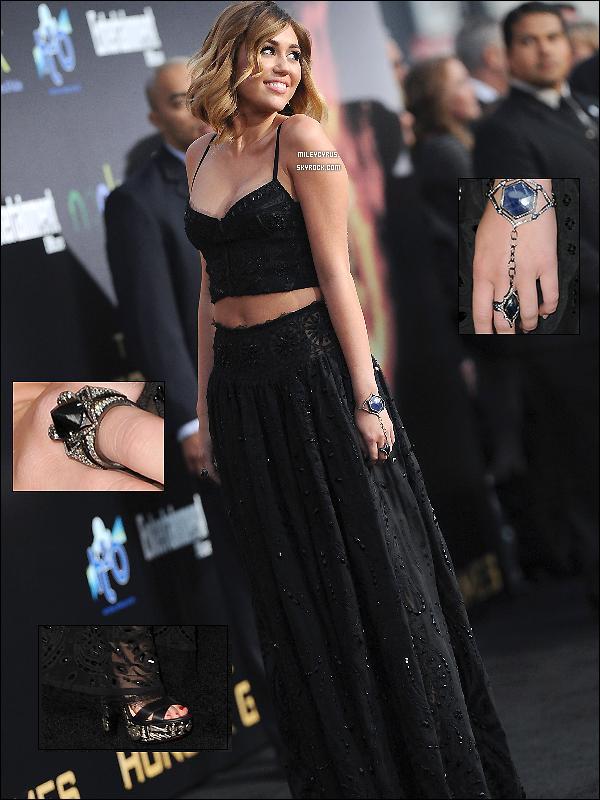 . 12/03/12 - Miley était présente à l'avant première de Hunger Games avec sa famille pour soutenir son petit ami Liam à Los Angeles. (VIDEO1 _VIDEO2) Concernant sa tenue, elle portait un ensemble Emilio Pucci , des talons Louboutin et des bijoux Loree Rodkin. J'aime pas trop sa tenue. Mais je trouve Miley vraiment radieuse, elle est magnifique!. Top ou Flop ? .