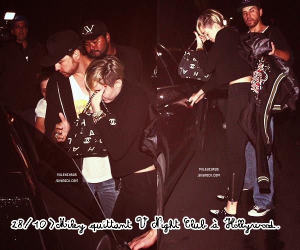 . | 30 octobre 2013 | Candids | Miley prés d'une piscine avec un ami.   Désolé pour la mauvaise qualité des photos :S    .