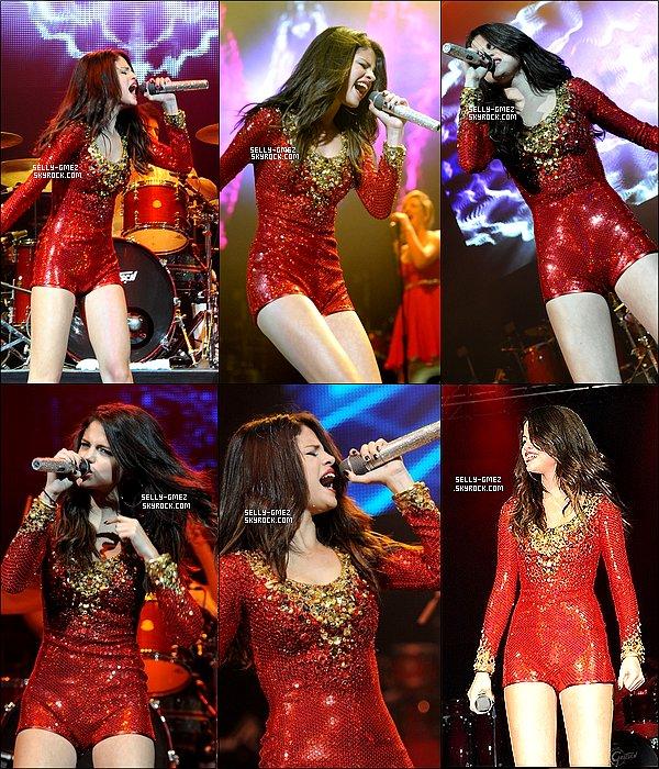 .    13/12/11 :  Selena durant sa performance au « 99.7 Triple Ho Show » à San Jose en Californie.Notre Selena était magnifique en combi rouge: retrouver les photos de sa performance ainsi qu'une vidéo filmée par une Fan .