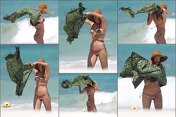 .  07/04/15 :  La top russe Irina Shayk était aperçue sautant d'un bateau semi-rigide sur les plages de Cancún, Top!   Et sous le soleil frappant du Mexique,  la belle russe avait piqué une tête près d'une plage en sautant d'un bateau semi-rigide. Shooting ?.  .