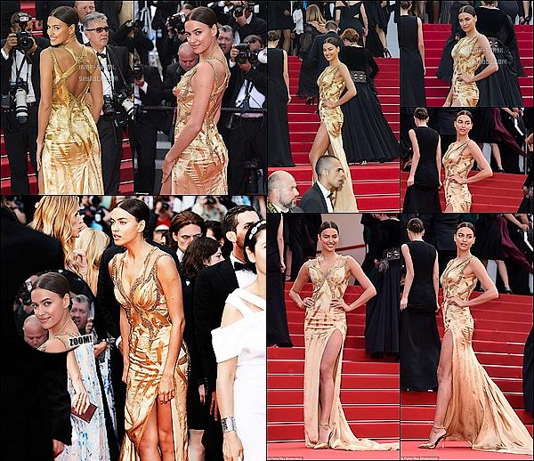 """.  19/05/15 :  Irina était présente sur le tapis rouge du célèbre   festival   de cannes avant la projection du film Sicario.   Irina , exquise en robe dorée Versace, monte les marches du Palais des Festivals avant la projection du film en compétition """"Sicario à Cannes    ."""