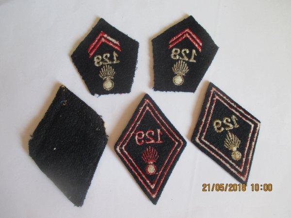 Quelques insignes  losangse de bras et pattes de col du 129e Rgt d'Infanterie ;