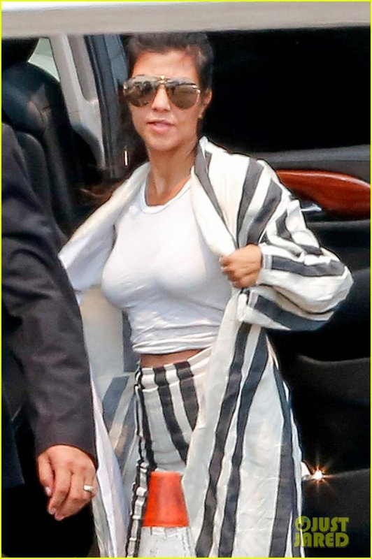 She's a runway model!Kourtney Kardashian flaunts her curves in tight crop best at airport in LA right after vacation with ex Scott Disick