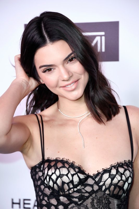 Kendall Jenner and Kylie Jenner share risqué photographs to tease upcoming 'DropOne' clothing drop