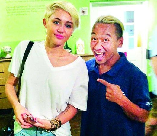 Miley avec un fan ou un ami