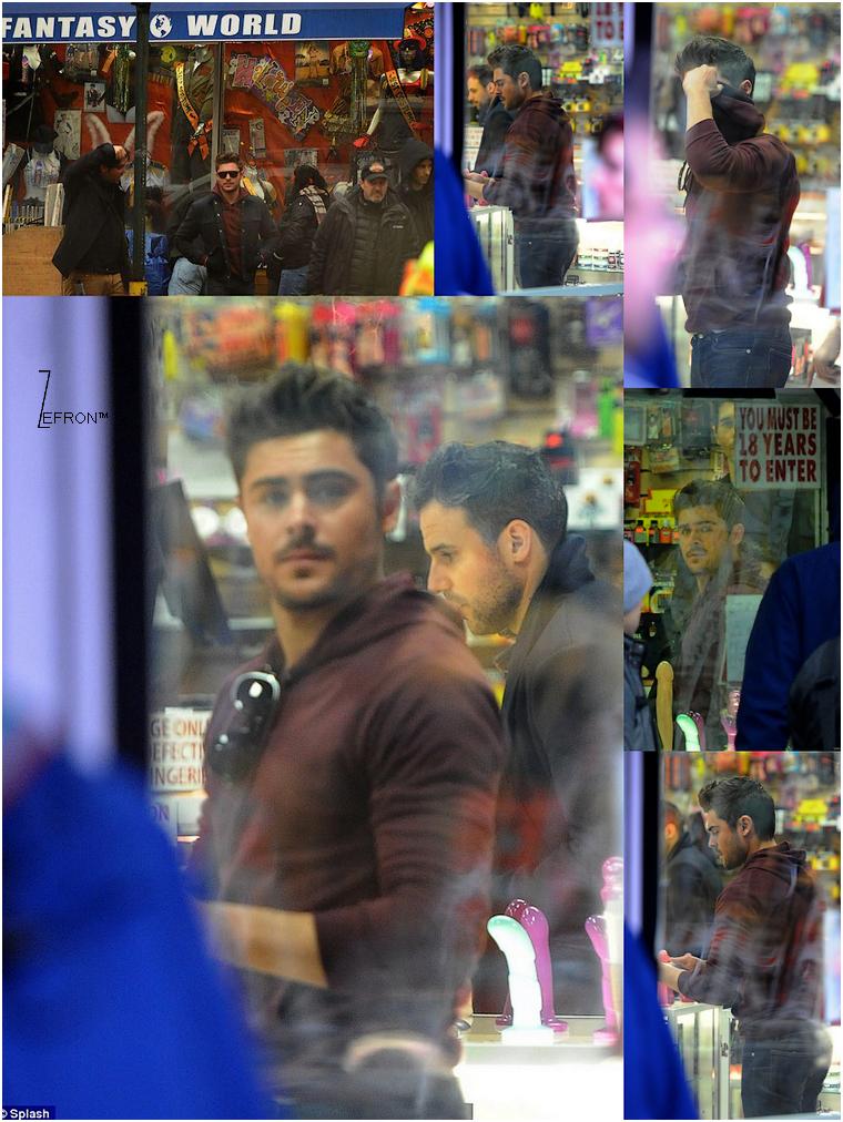 © ZEfron™  17.01.2013  -  Zac dans un sexshop pour les besoins du tournage d'AWOD? à New York, puis sous la pluie.   @J: Zac aurait demander au paparazzi's présent d'arrêter de prendre des photos par respect pour ses jeunes fan's!