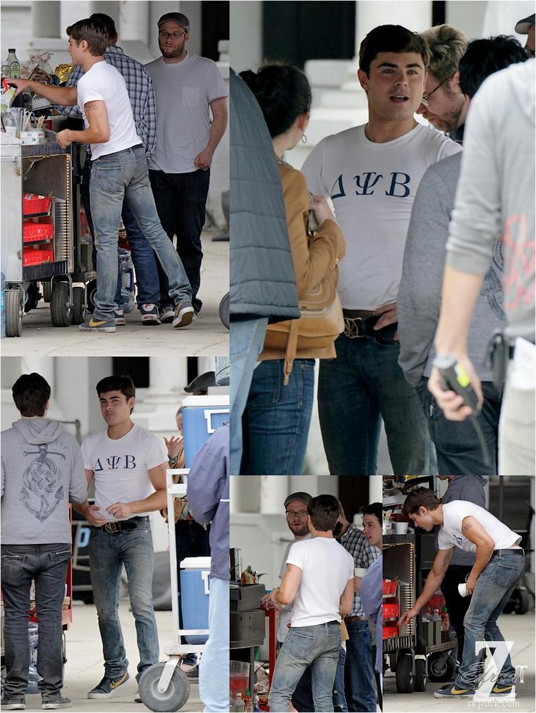 © ZEfron™  (Ajout de photos)  24.04.2013  -  Zac Efron, le tee-shirt de sa fraternité & Seth Rogen sur le tournage de Townies à Los Angeles.  @V: Pour une fois qu'il est habille sur le set. @J: Je le re-dis avant question, non Zac ne s'est pas fait de nouveau tatouage, c'est pour le film :)