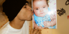 Chris Brown gives a kiss for an angel