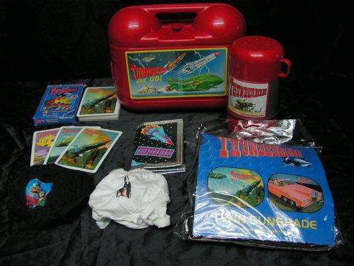 Les Picture-disc sont devenus quasi introuvables, ici, face A et face B, la litérature, des bagues à cigares, points Fina (carburant), puzzle, dolars de la banque Thunderbirds, Lunch Box, Porte monnaie, slip et pare-soleil pour voiture.