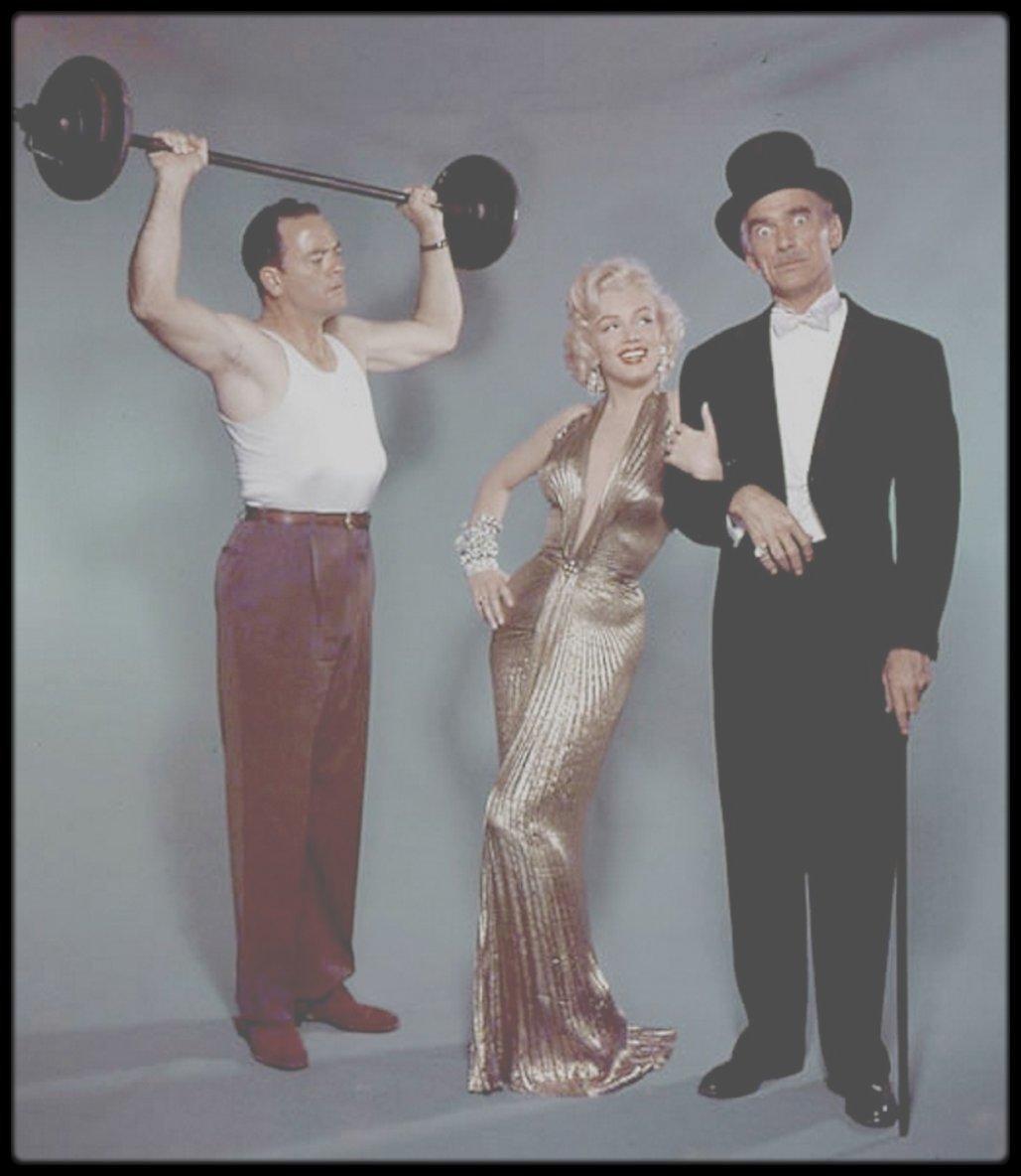 """HISTOIRE D'UNE ROBE / Le 9 Février 1953, afin de recevoir le prix de « La nouvelle star de l'année » que venait de lui décerner le magazine """"Photoplay"""", Marilyn se rendit au """"Beverly Hills Hotel"""" moulée dans une robe plissée lamée prétendument cousue sur elle puisqu'elle ne possédait ni bouton ou fermeture éclair. La légende prétant que Marilyn ne put enfiler la chose qu'après des heures d'irrigation colonique mais cette rumeur n'est pas assez suave pour que nous la colportions ici. L'histoire est en tout cas célèbre : cette robe, largement ouverte dans le dos et à l'origine décolletée jusqu'au nombril mais là quelque peu relevée, fit le lendemain la une de toute la presse et déclencha la fureur de Joan CRAWFORD, qui entama une croisade très médiatique contre Marilyn et la déchéance morale qui, de toute évidence, guettait Hollywood. Marilyn fut, déclara-t-elle, meurtrie par une telle attitude, d'autant qu'elle estimait Joan, si gentille avec elle au début de sa carrière… Marilyn accéda ce jour là à une notoriété qui ne s'arrêtera jamais et la robe contribua à faire de la « vedette de l'année » une icone, une robe dont elle est désormais totalement indissociable : c'est d'ailleurs la tenue la plus vendue de la """"Barbie Marilyn"""", juste devant la robe blanche de « 7 ans de réflexion ». Une robe donc, que Marilyn faillit pourtant ne pas porter. Une robe qui a une histoire, que nous allons à présent vous raconter.  Tout commence en 1951 dans les studios de la Fox où le jeune chef costumier, William TRAVILLA, transpire sur le prochain film de Ginger ROGERS, « Dreamboat ». TRAVILLA, auréolé d'un oscar pour son travail chez Warner sur « Les aventures de Don Juan » avec Errol FLYNN était entré à la Fox en 49. Et il était encore sous le charme de sa récente rencontre avec une jeune starlette du studio, une certaine Marilyn MONROE qu'il habillera dans 8 films mais il l'ignore encore. TRAVILLA était en tout cas assez fier de la robe lamée qu'il venait de créer pour Ginger, une r"""
