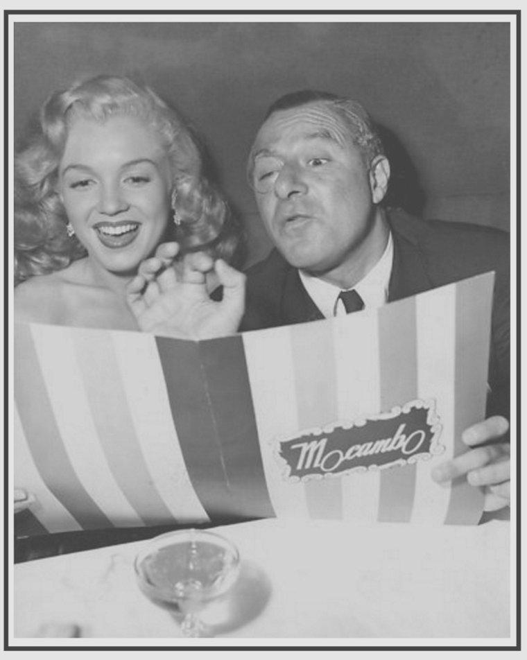 """1947 / Young Marilyn et le comédien George JESSEL lors d'une soirée au """"Mocambo Club""""."""