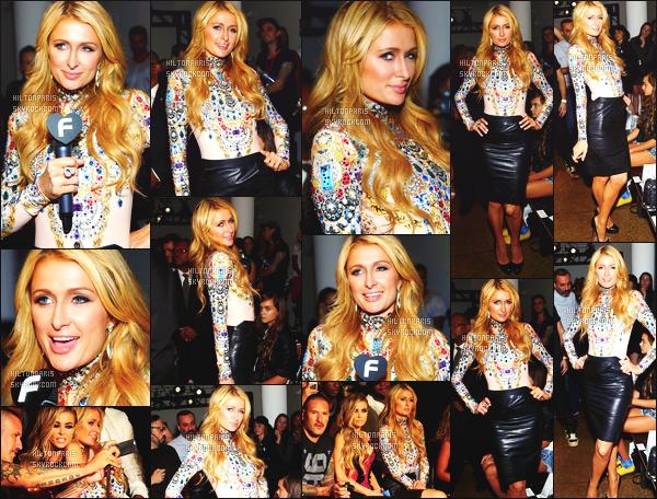 ------- 10/09/14: Notre sublime  Paris Hilton   photographiée assistant à la Fashion Week de « The Blonds » -   New York. Tenue belle et classe, Paris est sublime, j'adore son haut original et la jupe.  Gros top   pour ses cheveux bouclés super long. Je suis fan.   -------