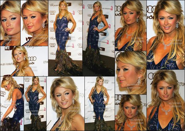 ------- 05/03/06: : La princesse Paris Hilton photographiée à l'événement « Academy Awards » organisé par Elton John.  J'aime beaucoup la robe, elle est trop belle Paris, et puis cette coiffure j'aime aussi, on dirait vraiment une princesse. Elle est trop sublime.      -------