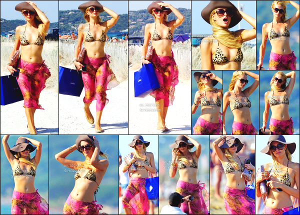 ------- 25/07/12:  Mlle Paris Hilton photographiée   dans la journée se baladant sur les plages toute suele  - à St Tropez.  J'aime assez ce maillot de bain sexy en léopard et son paero coloré rose/violet, top pour les lunettes et le chapeau. J'adore ses lunettes.  -------