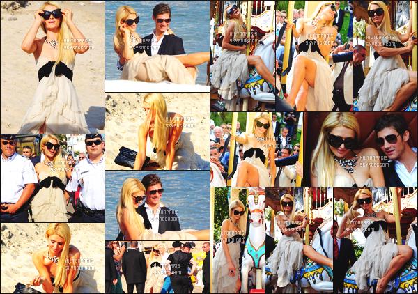 ------- 24/05/12: Mlle    Paris Hilton photographiée     sur la plage Majestic 65 se prenant en photo pour un shoot - Cannes.  La princesse Paris Hilton est dans la place. Même pour la plage Paris est vraiment sublime, j'adore trop cette grande robe, top. Top/Flop?     -------