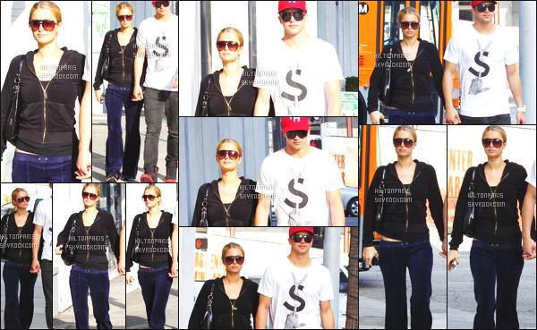 --------  26/11/12 :   Paris Hilton photographié avec son petit ami River Viiperi dans les rues de   Los Angeles. Paris aurait pu faire un effort vestimentaire pour cette sortie, elle est habillé comme une clocharde. Top pour le chignon. Top/Flop?  --------