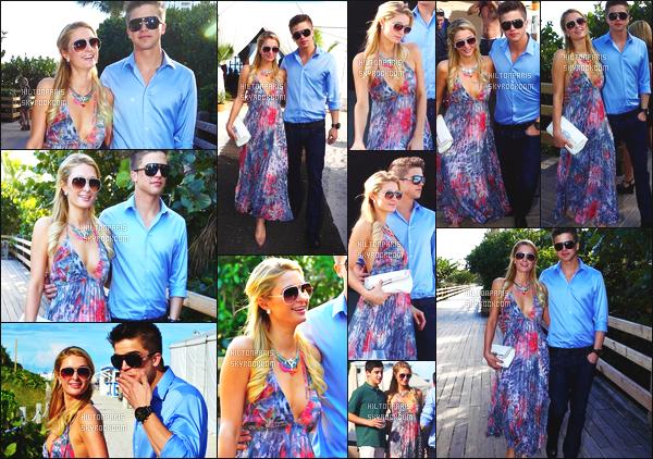 ------- 06/12/12: Mlle  Paris Hilton  photographiée   accompagnée de River pour assisté à un festival sur la plage à Miami.  Petit top pour cette robe trés souple, toute jolie, ample, elle est vraiment toute belle, j'adore ses lunettes de soleil. J'aime cette coiffure.  -------