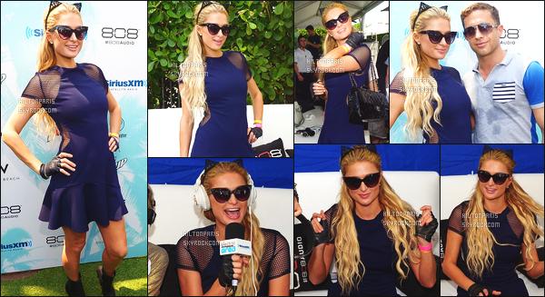 ------- 26/03/15:  Sublime Paris Hilton photographiée avec des fans dehors dans la journée, devant son hôtel - à Miami. J'aime beaucoup cette robe, elle est toute belle, j'adore ses lunettes de soleil,  gros top vraiment, j'aime aussi la coiffure  simple bouclé. -------